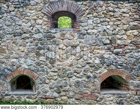 Wall Made From Of Big Stones From An Old Medieval Fortress In Brasov, Romania.