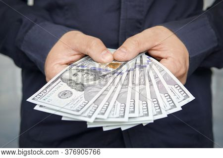 Male Hands With Wrist Watch Is Considered American Dollars. Hands Holding Dollar Cash. 1000 Dollars