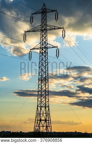 Beautiful Dramatic Sky And Clouds, Sunset Lights Over The Transmission Tower (electricity Pylon) On