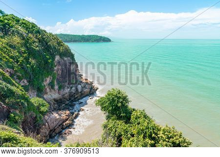 Koh Proet Island, The Atmosphere On An Island With Mountains And Trees Amid The Emerald Green Sea An