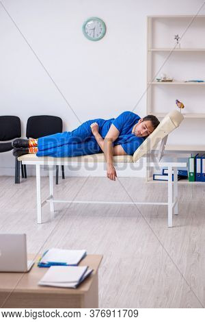Young male doctor being tired after night shift