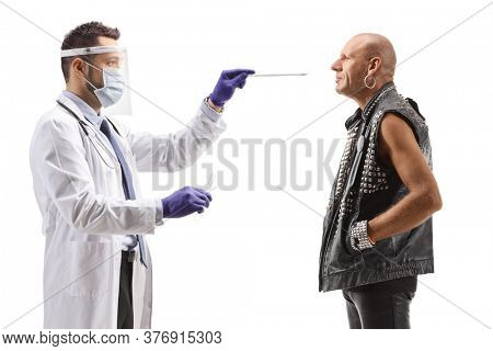 Male doctor with a face shield and mask taking a cotton swab test from a bald punk man isolated on white background