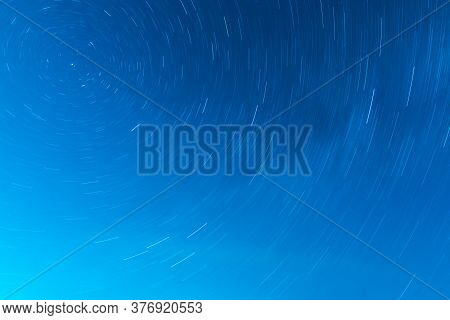Background Of Round Or Circular Star Track Or Trajectory On The Blue Clear Night Sky. Symbol Of Spac