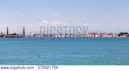Panoramic View From The Canal To Venice, Italy. Doge's Palace, Campanile Of The Cathedral Of St. Mar