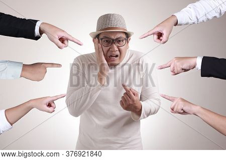 Asian Man Pointing Himself With Unhappy Displeased Expression As If He Confused To Be Accused And As