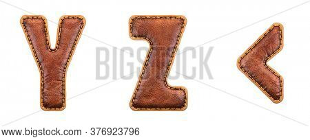 Set of leather letters Y, Z and symbol left angle bracket uppercase. 3D render font with skin texture isolated on white background. 3d rendering