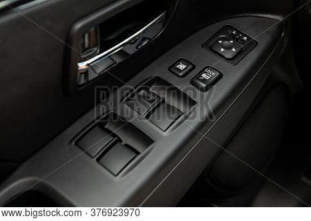 Novosibirsk/ Russia - July 04 2020: Mitsubishi Asx, Closeup Of A Door Control Panel In A New Car. Ar