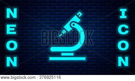 Glowing Neon Microscope Icon Isolated On Brick Wall Background. Chemistry, Pharmaceutical Instrument