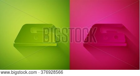 Paper Cut Electric Iron Icon Isolated On Green And Pink Background. Steam Iron. Paper Art Style. Vec