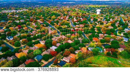 Colorful Rooftops And Fall Landscape Aerial Drone Views Above Thousands Of Homes And Houses In Subur