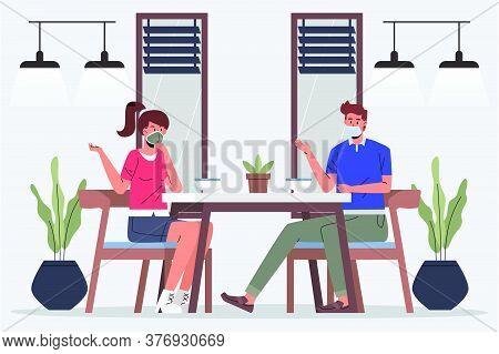 Social Distancing Workplace Or Restaurant. People Sitting When Meeting In The Office. A Man And A Wo