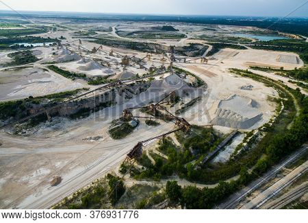 Pollution And Climate Change Shown From Above Over A Large Open Pit Mine With Old Mining Extraction