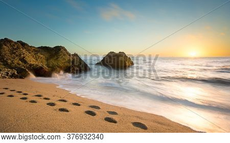 Photo Of The Pebble Beach Of Cowell Ranch Near Half Moon Bay On The California Coast.  Sunset Scene