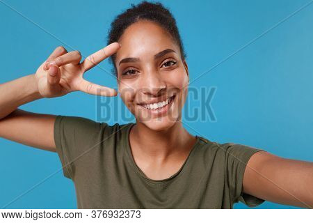 Close Up Of Funny Young African American Woman Girl In Casual T-shirt Isolated On Blue Background. P