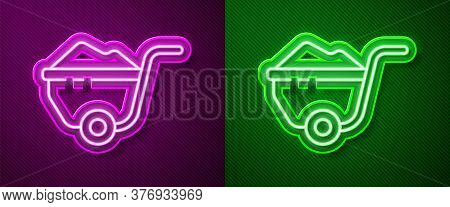 Glowing Neon Line Wheelbarrow With Dirt Icon Isolated On Purple And Green Background. Tool Equipment