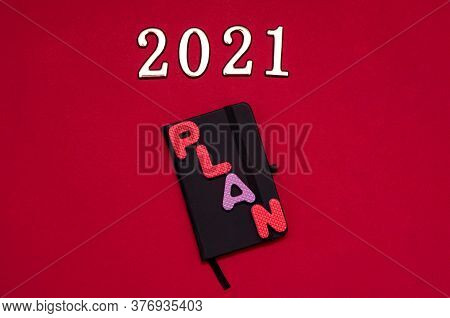 Plan 2021. Silver Numbers 2021 With Alphabet Letter On Red Background