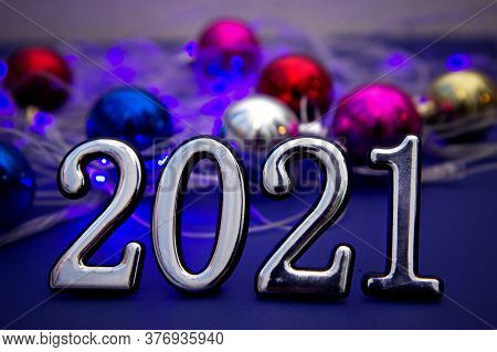 Happy New Year 2021. Silver Numbers. Year Of The Bull. Blurred Blue Light Background.