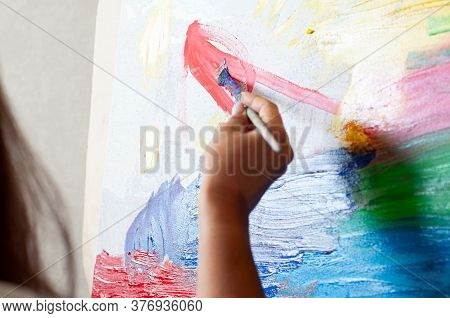 Female Artist Works On Abstract Painting, Moving Paint Brush Energetically She Creates Modern Master