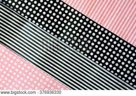 Wrapping Paper In A Pink And Black Stripe And Dot Pattern For Use As A Background