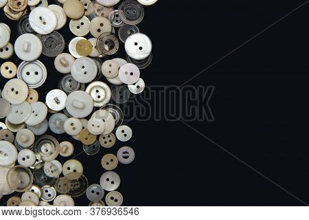 Sewing Buttons Background. White Sewing Buttons Texture And Patterns On Black Background