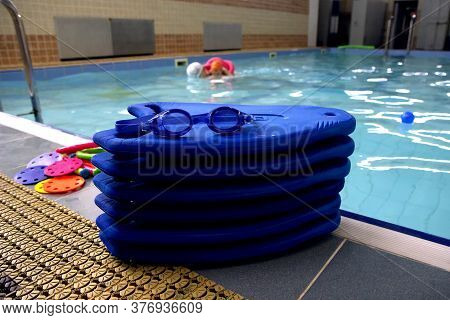 Blue Swimming Boards With Swimming Glasses And Toys Of The Pool
