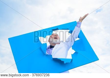 Emotions. Success. Bearded Man Peeking From Ripped Paper Hole. Man Making Hole In Paper. Discount. S
