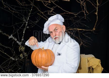 Big Pumpkin For Halloween. Bearded Cook In Chef Hat With Pumpkin. Diet Food. Chef Man In White Apron