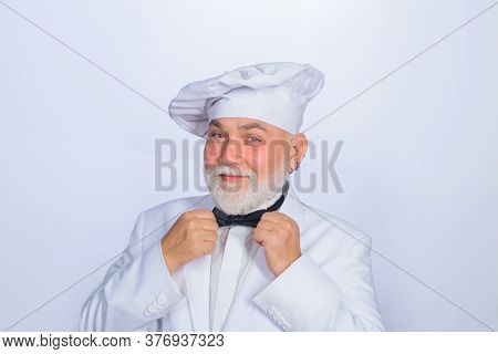 Male Chef In White Uniform. Cooking. Old Bearded Cook. Cooking Concept. Professional Chef Man. Happy