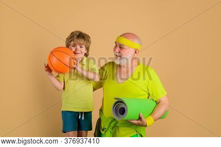 Sporting. Sport Game. Family Time Together. Family Sport. Portrait Of A Healthy Grandfather And Son