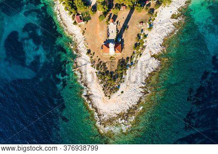 Lighthouse Of Veli Rat On The Island Of Dugi Otok, Croatia, Beautiful Seascape And Rocks, Overhead V