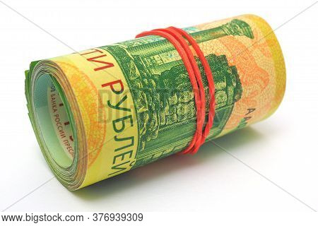 Two Hundred Rubles Rolled Up Russian Banknotes. High Saturation And Contrast. Not Isolated. Macro