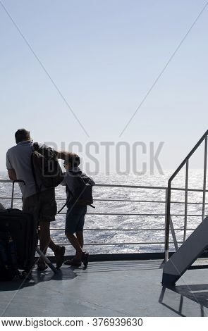 Aegean Sea / Greece / September 15 2019 : Father And Son On The Deck Of An Inter Island Ferry, On A