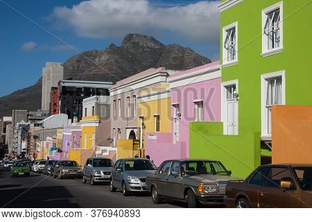 Bo-kaap, Cape Town, South Africa June 18 2012: colorful houses of the Bo-kaap district in Cape Town South Africa. Many tourists visit this neighborhood.