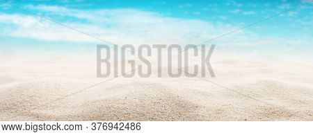White Sandy Beach With A Sea View. Close-up With Short Depth Of Field And Space For Text. Background