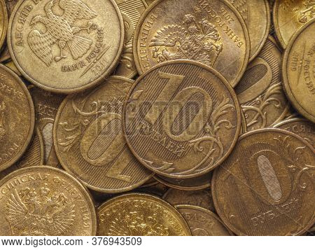 Russian Coins At 10 Rubles. Field Of Money Close Up. Illustration, Top View. Economics And Banks Of