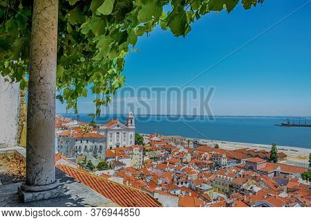 Beautiful Panoramic View From Santa Luzia Viewpoint To Alfama Old Town, With Santa Estevao Church An
