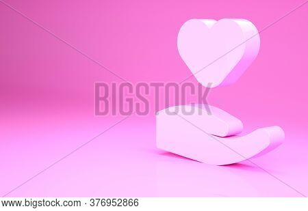 Pink Heart In Hand Icon Isolated On Pink Background. Hand Giving Love Symbol. Valentines Day Symbol.