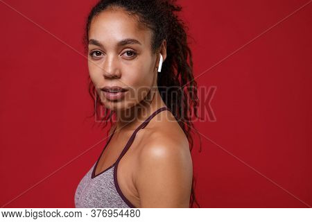 Side View Of Beautiful African American Sports Fitness Woman In Sportswear Working Out Isolated On R