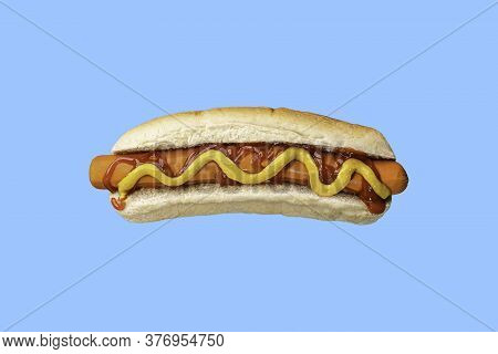 Hot Dog With Ketchup And Mustard On White Bread