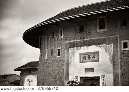 FUJIAN, CHINA – MARCH 2, 2018: Chengqi Lou is among one of the most known Tulou buildings. Tulou is the unique traditional rural dwelling of Hakka.