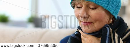 Close-up Of Ill Elderly Woman Blowing Nose In Paper Scarves. Unhealthy Granny On Sick Leave. Female