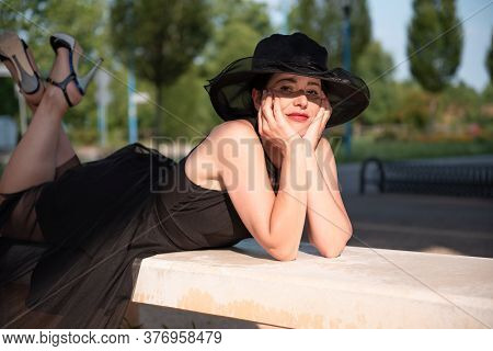 Beauty Portrait Of Retro Elegant Woman Is Lying On Belly, Holding Head By Hand.