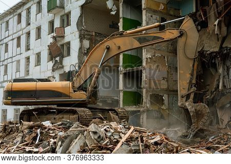 Demolition Of A Five-story Apartment Building Recognized As Emergency Housing, Close-up Of An Excava