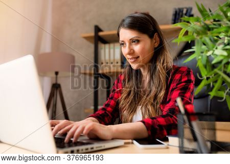 Girl Teleworker Works At Home With A Laptop