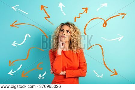 Confused Woman Have To Choose The Right Arrow To Follow. Concept Of Options, Confusion, Decision.