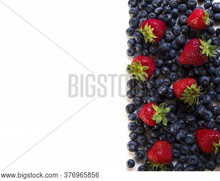 Fresh Fruits. Healthy Food. Mixed Fruits, Strawberries And Blueberries. Studio Photography Of Variou