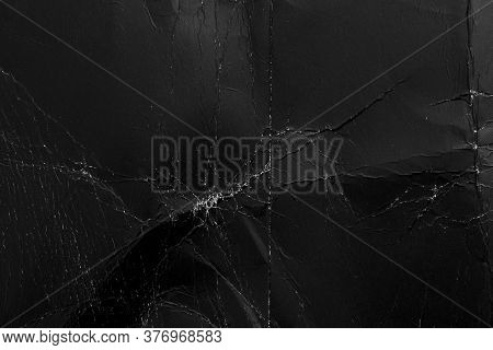 Shabby Black Paper With Creases And Dust. Damaged Packaging Old Material. Abstract Background. Macro