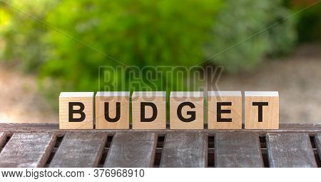 Budget Word Written On Wood Block. Budget Text On Wood Table, Concept
