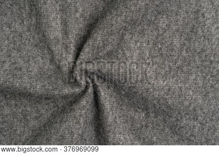 Woolen Gray Warm Material Close-up With Folds And Pattern. Abstract Background. The Concept Of Comfo