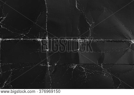 Black Old Paper With Folds And Roughness. Abstract Dramatic Background. For Design And Titles.